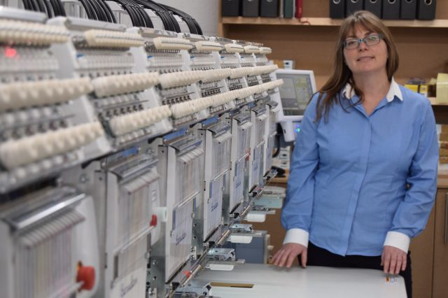 Head of Operations, Nicky Mather with the new Barudan embroidery machine